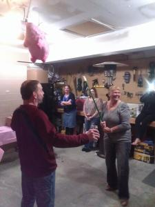 My Grandma getting ready to destroy a pig pinata at her 70th Birthday.